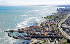 Strand Gordon's Bay - from Cape Town - Harbour Island marina development in the front with Greenways Golf Estate and Strand Beach Road on the horison. Golf Estate, Real Estate, South African Holidays, African Love, Namibia, Cape Town South Africa, Beach Road, Out Of Africa, Dream City