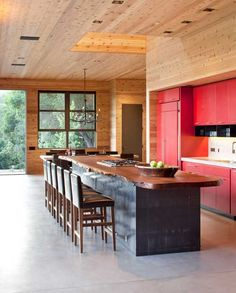 I want those walls - and red cabinets!  Red = Contemporary  Repined by Yourfavorite Organizer on FB www.neatandsimpleorganization.net