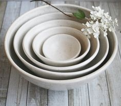 "This nesting set of five bowls was hand thrown and trimmed on my pottery wheel using a white stoneware clay. They were bisque fired and glazed with white speckled glaze that has a smooth satin finish and high fired in my electric kiln. This set is really beautiful and would make a lovely wedding gift or special occasion gift for a gourmet lover.Approximate Sizes:9.5"" across the top and 4.5"" high.8"" across the top and 4"" high.6.5"" across the top and..."