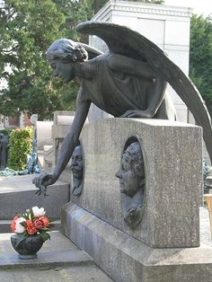 Angel watching over the grave -- interesting to have busts of the man + woman on the headstones, too.