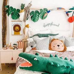 2019 Black Friday deals on Kids room ideas. How to create beautiful jungle room theme on a budget with ikea children's accessories or DIY monstera leaf bunting. Ikea hack this pink kids cabinet and accessorise with giant stuffed animals Jungle Theme Rooms, Boys Jungle Bedroom, Safari Bedroom, Room Boys, Safari Theme, Bedroom Wall, Ikea Kids Bed, Lion Nursery, Casa Kids