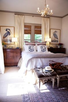 dressers as bedside tables, curtains as headboard, & monogram pillows
