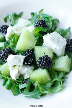 Salad with melon, blackberries and feta cheese.