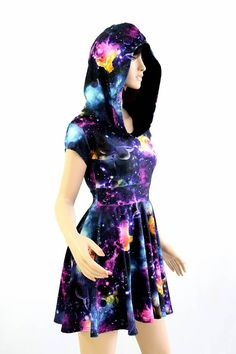 This item is made to order, please read all the way through the listing before purchasing! Out of this world! This unique galaxy print dress dress is flirty and fun, stretchy and sexy! The four way stretch lycra spandex is comfortable and figure flaunting. The top is darted for a