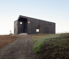 A Black Timber Home in Chile Echoes Local Volcanic Stone #chile #hometour #timber