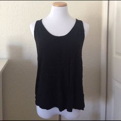 """Old Navy Button Back Tank Top Cute basic black tank top with buttons that go all the way up the back.  Has no fading despite the pic, minor pilling probably picked up from other clothes because I am pretty sure I've never worn this top! In excellent condition. 33"""" long, 18 1/2"""" armpit to armpit. Old Navy Tops Tank Tops"""