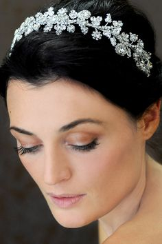 Rhinestone headband of rhinestone flower, pendants, chain, rhinestones and filigree leaves.