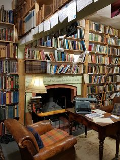 A room with rows of shelves filled with books, a leather armchair and a wooden table with a typewriter on top Toddler Rocking Chair, Childrens Rocking Chairs, Pub Chairs, Kitchen Chairs, Brown Accent Chair, Small Grey Bedroom, Beach Chair With Canopy, Home Libraries, Wooden Tables