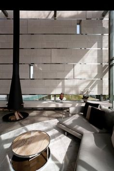 Eclectic modern living on Lake Geneva. Powerful sculptural forms and the bold use of colour, with dramatic compositions create striking interiors. Architecture by SAOTA Light Granite, Timber Screens, Travertine Floors, Timber Panelling, Eclectic Modern, Luxury Furniture Brands, Design Blogs, Architectural Features, Wall Treatments