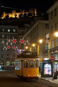 Lisbon By Night at Christmas time - with the St George Castle on the top of the hill Portugal