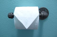 How to make an easy, industrial toilet paper dispenser.  It seriously took 10 minutes (including the time it took to mount it)!!