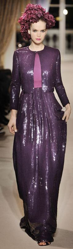 except for the dead dried hydrangea on her head, this ensemble is quite lovely ----Giambattista Valli