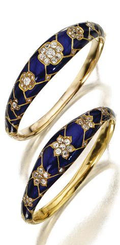 TWO GOLD, ENAMEL AND DIAMOND BANGLE-BRACELETS, CIRCA 1870 The hinged bangles of tapering form decorated on the front with royal blue enamel in a woven design, accented with flowerheads of old-mine and rose-cut diamonds, the backs partly engraved with scrolling foliage.