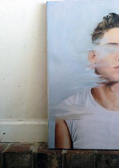 possibility for a self portrait maybe? Interesting the way the paint covers part of the portrait.. almost like the person is in motion.