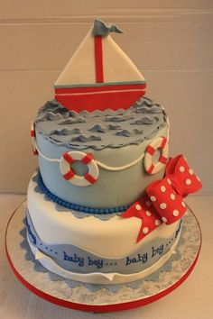 This cake was for a baby shower. The cake was red velvet with cream cheese filling. The cake was covered in fondant and decorated using gumpaste for the topper and the bow. TFL.