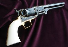 """Colt 1851 Navy s/n 10483 - Second generation, """"C"""" Series, (Completed in November, 2010 by Christopher Malouf)  Featuring: Elephant ivory grips by Jim Alaimo of Nutmeg Sports, Case color by Turnbull Mfg., Gold plating by Reliable Plating and bluing by Steven Cale of Scott Depot, West Virginia.  Engraving: 24k fine line, flush inlay fourishes, borders, barrel address and serial numbers. Traditional scroll with mild relief background and super fine bead punched background."""