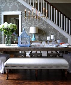 I like the six leg bench upholstered with muslin and nailhead trim