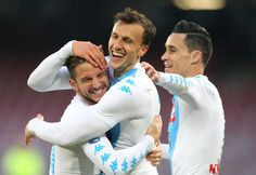 Napoli's defender from Romania Vlad Chiriches (C) celebrates after scoring with teammate Napoli's forward from Belgium Dries Mertens (L) and Napoli's forward from Spain Jose Maria Callejon during the Italian Serie A football match SSC Napoli vs Torino FC on December 18, 2016 at the San Paolo Stadium in Naples. / AFP / CARLO HERMANN