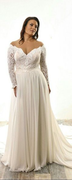 Plus size lace bridal gown with long off-shoulder sleeves and chiffon skirt. Lida. Studio Levana