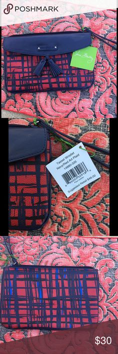 Red and navy Art Plaid Vera Bradley Wristlet NWT Red and navy Art Plaid Vera Bradley Wristlet .  Faux leather.  Two compartments - one in the front under the tasseled flap and a zippered one that has 2 card pockets.  Short loop strap handle on th end.  NWT. Vera Bradley Bags Clutches & Wristlets