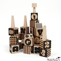 Wood Typography Blocks These handmade wooden alphabet factory blocks are inspired by the original House Industries factory logo and feature a generous selection of letters, numbers and symbols from Houses timeless font collections.