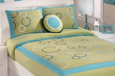 I love the lime green used on this unisex childrens bedding by Ashley Furniture