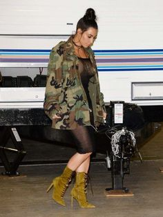 Kim Kardashian arrived at a party in L.A. sporting a Life of Pablo oversized camo jacket and Yeezy Season 3 green suede lace up boots.