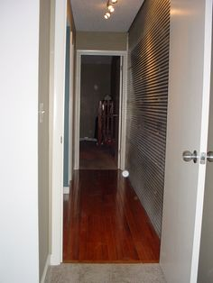 """Lake St Louis Condo Remodel  Upstairs hallway """"steel"""" wall    Work by Architectural Elements"""
