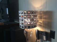 Lampshade made of 1960s and 70s slides. Sept 2015.