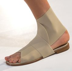 Minimalist sport footwear from victoriabeckham in beige perfectly compliments her clean designs #nyfw #ss13