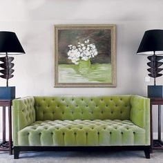Love the olive green velvet tufted sofa that takes it's cue from the lovely painting above it. (or visa versa) The teal blue & mahogany side stands w/ black lamp shades are a nice compliment to the setting. ~Cat @MetalCatatonic