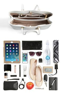 This travel tote can fit all of your essentials including your iPad, phone, sunglasses, an umbrella, your makeup, a notebook, your keys, a bottle of water, a pair of flats, your wallet and credit cards.