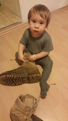 Trying to put on my combat boots.