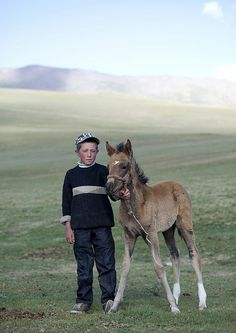 Boy and colt, Kyrgyzstan - by Eric Lafforgue
