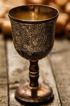 Medieval goblet and wine corks on wooden table Stock Photo