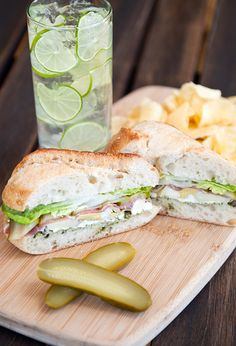 This sandwich has some of my favorite things: pesto, feta, artichoke hearts, prosciutto and dill pickles. All on a crusty baguette. Yum!