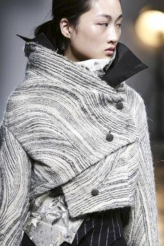 Asymmetrical jacket with spliced woodgrain pattern; fashion details // Aganovich Fall 2015