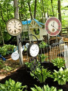 I wouldn't do the Disney theme, but hanging a bunch of old clocks/sundials on the backyard fence might be cute.