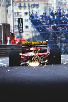 Formula 1 Ferrari at the Monaco Grand Prix, spotting out some sparks.