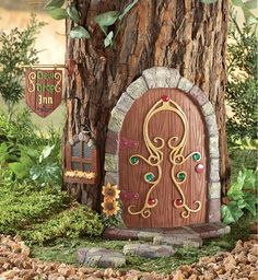 "Enchanted Garden Miniatures - This Fairy Garden Door and accessories goes on the base of your tree.  You get a ""Dew Drop Inn"" sign, window, and steps too!"