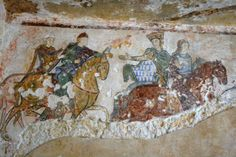 Mural at Chinon - figures with cloaks fastened at right shoulder.