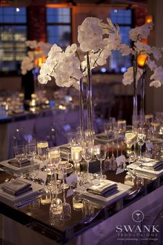 Planned, Designed & Produced by www.swankproductions.com Modern chic wedding decor. Mirrored tables. White orchid centerpiece. Tribeca rooftop NYC
