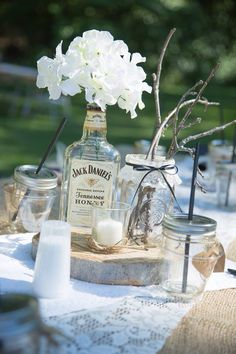 Jack Daniels honey hydrangea rustic wedding centerpiece- ask bars to save booze bottles for you!