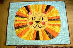 Cute lion baby quilt - i bet i could do something like this using a different medium.