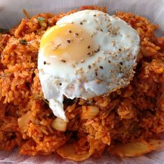Kimchi Fried Rice! This looks like the most Korean piece of food Ive ever seen! Eggs, rice, kimchi, and sesame seeds!