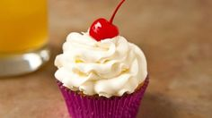 Blogger Angie McGowan of  Eclectic Recipes takes the tropical flavors of a Mai Tai and turns them into a cupcake treat!
