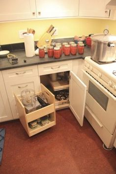 Blind Corner: Previously, there was not any cabinet space in the corner next to the stove.  A blind corner cabinet and an insert uses the space better.  The first part pulls out and swings wide, and two sliding shelves behind slide into the opening in the cabinet.  This insert was made by Omega National.