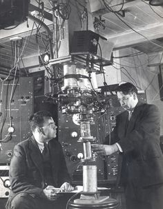 Edward Uhler Condon and J.E. Hill examining the Atom Smasher, 1940