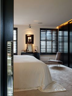 Large louvered wenge shutters are minimilistic and unfussy.