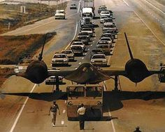 Sr71 in transit  COME ON GUYS ,,,IT'S EASIER TO FLY.......